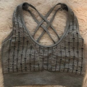 Distressed sports bra with cross cross straps